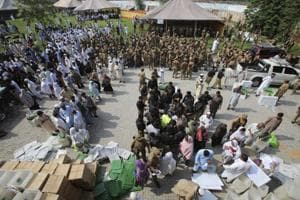 Pakistan election 2018: Polling staff gather at a distribution centre to receive voting material for elections, in Peshawar, Pakistan, Tuesday, July 24, 2018.