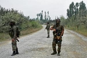 Army personnel stand guard during a gun battle with militants, who launched a pre-dawn attack on a district police complex in which three security personnel were martyred, in Pulwama of South Kashmir.