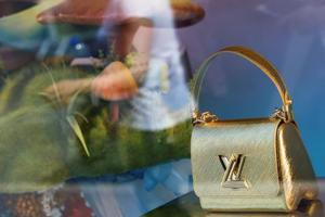 The logo of Louis Vuitton is seen on a handbag at a Louis Vuitton store in Cannes, France.