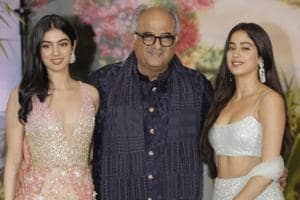 Producer Boney Kapoor along with his daughters Janhvi Kapoor and Khushi Kapoor at the wedding reception of actor Sonam Kapoor and businessman Anand Ahuja in Mumbai.