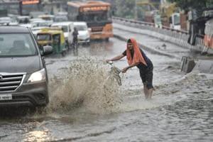 Photos: Heavy rain in Delhi-NCR causes traffic jams, waterlogging