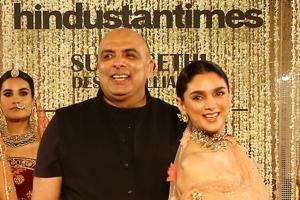 Tarun Tahiliani walks with Aditi Rao Hydari at the India Couture Week.