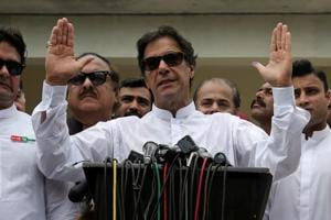 ricket star-turned-politician Imran Khan, chairman of Pakistan Tehreek-e-Insaf (PTI), addressing media after casting his vote at a polling station during the general election in Islamabad on July 25, 2018.