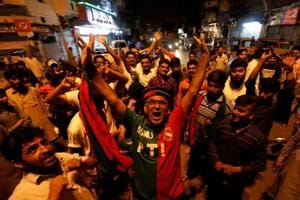 Supporters of the Pakistan Tehreek-e-Insaf (PTI) celebrate during the general election in Karachi on July 25.