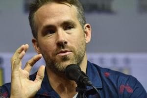 Canadian actor Ryan Reynolds addresses the crowd on stage for Deadpool panel at Comic Con in San Diego.