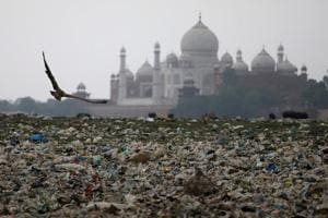 Garbage is seen on the polluted banks of the river Yamuna near the historic Taj Mahal in Agra.