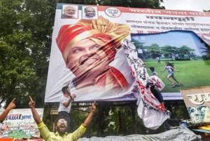 Maratha Kranti Morcha protesters vandalise a poster of Maharashtra Chief Minister Devendra Fadnavis during their statewide bandh, called for reservations in jobs and education, in Thane.