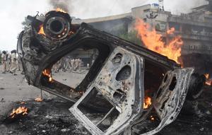 Protesters burnt down vehicles at Kopar Khairane in Navi Mumbai on Wednesday.