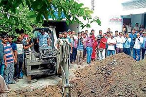 A site on the shelter home campus at Muzaffarpur being dug on suspicion that a rape victim was allegedly buried there.