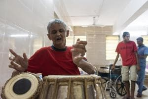 Ashok Soman, 60, plays the tabla at the Adhar home in Greater Mumbai. This 5-acre facility was set up by a group of parents; it now houses 220 people aged 18 to 75. A second home was recently opened in Nashik.