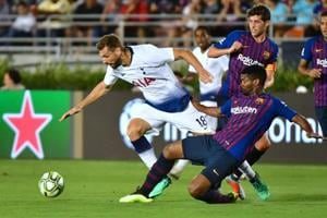 Marlon Santos of Barcelona fights for the ball with Fernando Llorente of Tottenham Hotspur in International Champions Cup