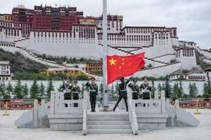 The Chinese national flag is raised during a ceremony at Potala Palace in Lhasa, Tibet Autonomous Region, China on July 1, 2017.