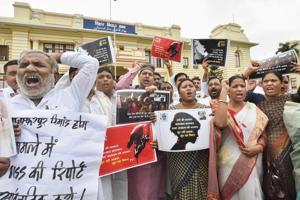 Political parties protest against the Bihar shelter home case during the ongoing Monsoon Session at the Bihar Assembly in Patna on July 24, 2018.