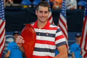John Isner poses with the trophy after defeating Ryan Harrison during the Atlanta Open final.