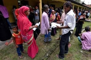 Villagers wait outside the National Register of Citizens centre to get their documents verified by government officials, at Mayong Village in Morigaon district, Assam.