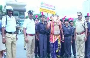 A man dressed as Lord Ganesha participates in the road safety drive in Baengaluru on July 30.