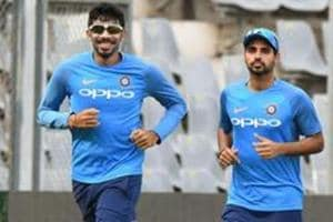 Jasprit Bumrah (L)and Bhuvneshwar Kumar are both going to miss India's Test series against England due to injury.