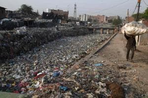 File photo of a sewage drain canal full of garbage in the Taimur Nagar slum area in New Delhi.  The Plastic Waste Management Rules, notified by the union ministry in March 2016, had introduced several new features and brought about a collect-back system to deal with such waste.