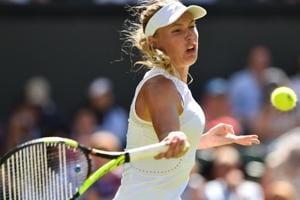 Caroline Wozniacki returns to Varvara Lepchenko during their women