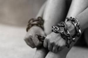 Eight alleged traffickers were arrested after a raid on six brothels.