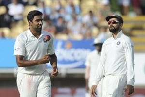 Indian cricket captain Virat Kohli (R) speaks to bowler Ravichandran Ashwin during the first day of the first Test cricket match between England and India at Edgbaston in Birmingham, England on August 1, 2018.