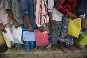 People queue up to check if their names are included in the National Register of Citizens in Bur Gaon village,  Assam.
