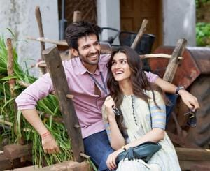 Kartik Aaryan and Kriti Sanon light up the picture with their big smiles.