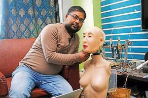"Ranjit Srivastava with his Hindi speaking humanoid robot ""Rashmi"", at his residence in Ranchi on Tuesday."