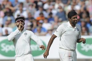 Indian cricket captain Virat Kohli, left, and Ravichandran Ashwin celebrate the dismissal of England