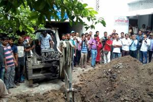 Police investigate the site where a rape victim was alleged buried, at a government shelter home in Muzaffarpur.