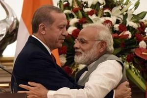 Prime Minister Narendra Modi hugs the Turkish President Recep Tayyip Erdogan (L) after exchange of agreements and Press Statements at Hyderabad House in New Delhi.