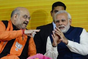 Prime Minister Narendra Modi and BJP party president Amit Shah at the party headquarters in New Delhi.
