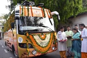 Chief minister Vasundhara Raje performs puja of the rath (bus) that will be used for