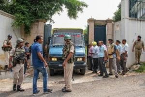 Security personnel at the residence of former Jammu and Kashmir Chief Minister Farooq Abdullah after his security was breached by a man, in Jammu on Saturday, Aug 4, 2018.