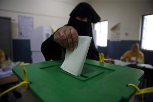A voter casts her vote at a polling station during the general election in Islamabad, Pakistan.