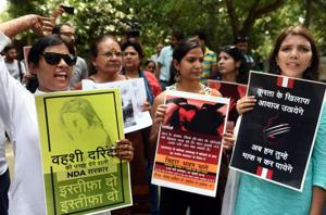 Member of different NGO shout slogans against Nitish Kumar during a protest over the issue of alleged sexual abuse at a government-funded shelter home in Muzaffarpur district, at Bihar Bhawan in New Delhi.