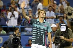 Alexander Zverev, of Germany, waves to the crowd after he defeated Kei Nishikori, of Japan, 3-6, 6-1, 6-4 during the Citi Open tennis tournament.
