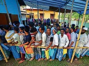 People wait in queue to check their names on the draft list at the National Register of Citizens (NRC) centre at a village in Nagaon district in Assam. The Uttarakhand BJP wants an NRC in the state to check entry of infiltrators.