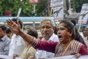 Communist Party of India (Marxist) activists take part in a protest rally against the Assam