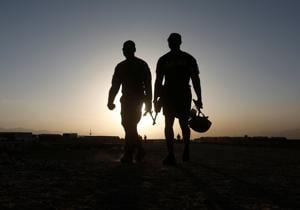 US troops walk at their base in Logar province, Afghanistan on August 4.