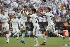 Marco Asensio #20 of Real Madrid celebrates with his teammates after scoring a goal against Juventus in the second half during the International Champions Cup 2018 at FedExField on August 4, 2018 in Landover, Maryland.