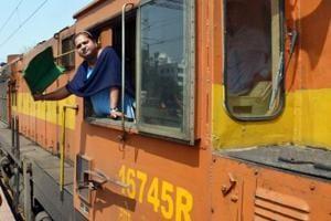 RRB ALP admit card: A woman loco-pilot flags off the Ranchi-Lohardaga-Tori passenger train on International Women