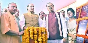 Union home minister Rajnath Singh (centre) unveilling the projects in the presence of CM Yogi Adityanath and deputy CM Keshav Prasad Maurya.