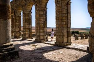 Tourists walk through the ruins of the ancient Roman site of Volubilis, near the town of Moulay Idriss Zerhounon in Morocco