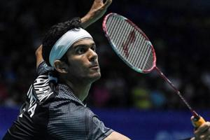 Ajay Jayaram hits a return against Son Wan-ho during their quarter-final match at the Malaysia Open Badminton Superseries.