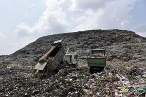 Trucks dumping garbage at Ghazipur Landfill site in New Delhi.