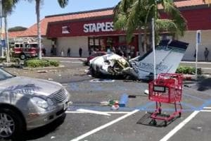 The debris of a plane which crashed into a parking lot is seen in Santa Ana, California on August 5.