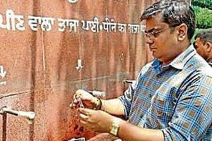 Health inspector checking water sample from one of the taps at Ludhiana railway station on Monday