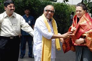 Former Tamil Nadu chief minister M Karunanidhi presenting a shawl to Congress chief Sonia Gandhi at Neew Delhi in June 2006.