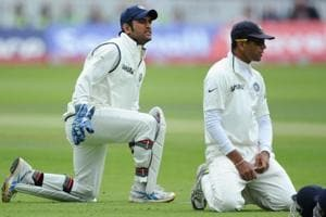 MS Dhoni (L) and Rahul Dravid react after dropping Jonathan Trott of England during the first test match between England and India at Lord